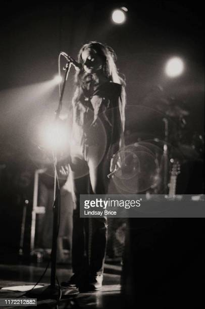 Vocalist Hope Sandoval stands with both arms down as she performs in Mazzy Star at the Hollywood Palladium on November 26 1994 in Los Angeles