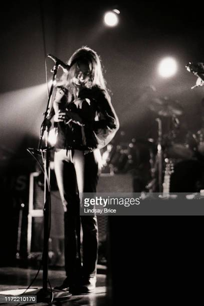 Vocalist Hope Sandoval turns her head downward to her left as she performs in Mazzy Star at the Hollywood Palladium on November 26 1994 in Los Angeles