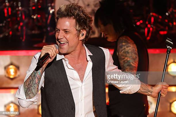 Vocalist James Michael of SixxAM performs at iHeartRadio Theater on October 7 2014 in Burbank California