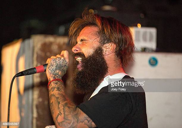 Vocalist Jason Aalon Butler of the band Letlive performs injured with his arm in a cast at The Emerson Theater on December 13 2013 in Indianapolis...