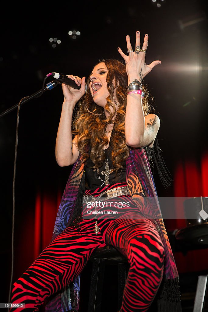 Vocalist Juliet Simms of Automatic Loveletter performs at the Vans Warped Tour press conference and kick-off party at Club Nokia on March 28, 2013 in Los Angeles, California.