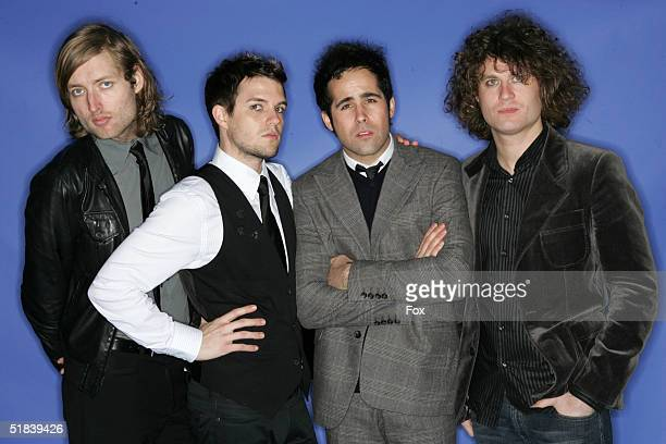 Vocalist keyboardist Brandon Flowers guitarist David Keuning bassist Mark Stoermer and drummer Ronnie Vannucci of The Killers pose for a portrait...