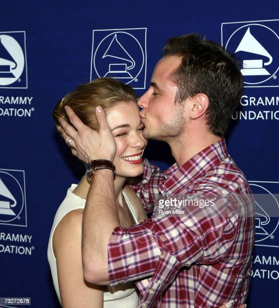 Vocalist LeeAnn Rimes recieves a kiss from Dean Sherement as they arrive at the 9th The Soul of Country Annual Grammy Foundation Music Preservation...