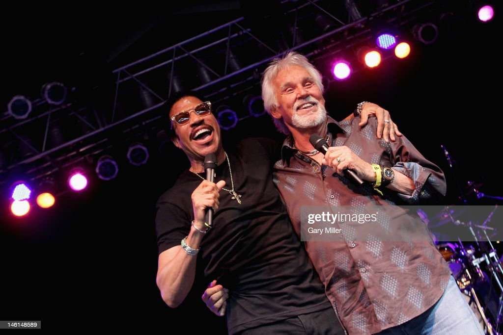 Vocalist Lionel Richie (L) joins Kenny Rogers as a surprise guest during the 2012 Bonnaroo Music and Arts Festival on June 10, 2012 in Manchester, Tennessee.
