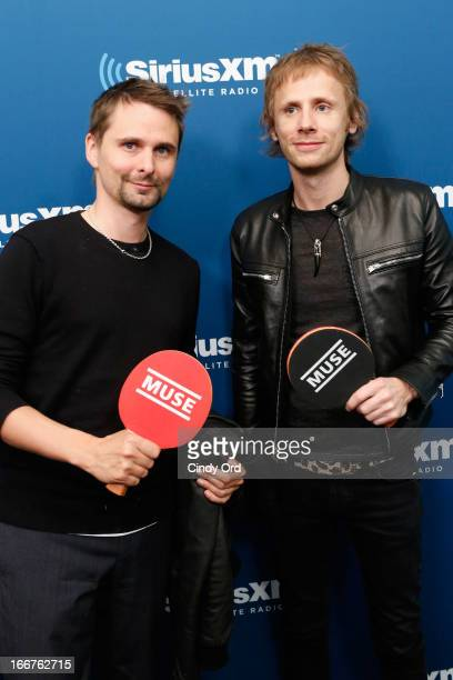 Vocalist Matthew Bellamy and drummer Dominic Howard of Muse pose before playing ping pong during the firstever 'Alt Nation Ping Pong Throwdown' at...