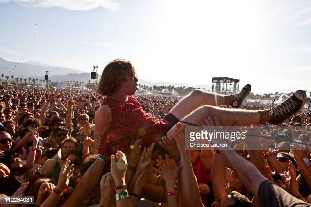 Vocalist Matthew Shultz of Cage The Elephant crowdsurfs while performing at day 2 of the 2011 Coachella Valley Music Arts Festival at The Empire Polo...