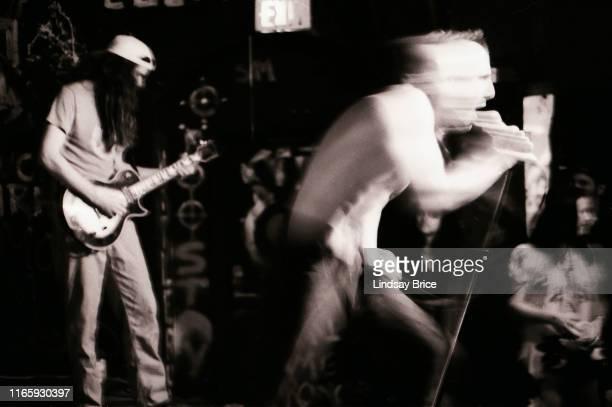 Vocalist Maynard James Keenan and guitarist Adam Jones perform in Tool at Al's Bar on November 25 1991 in downtown Los Angeles
