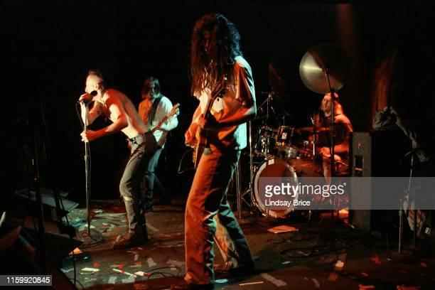 Vocalist Maynard James Keenan bassist Paul D'Amour guitarist Adam Jones and drummer Danny Carey perform in Tool at the band's Zoo Entertainment...