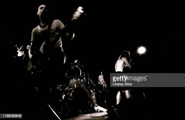 Vocalist Maynard James Keenan bassist Paul D'Amour guitarist Adam Jones and drummer Danny Carey perform in Tool at the Fairfax High School Gymnasium...