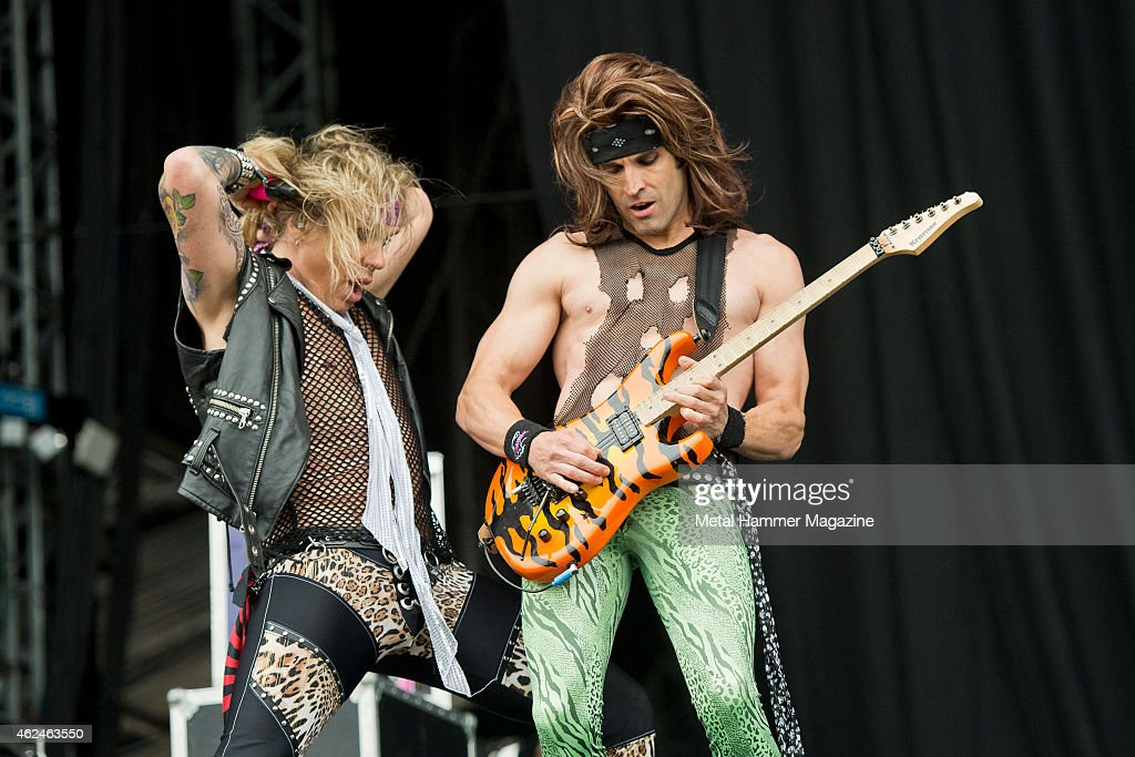 Vocalist Michael Starr (L) and guitarist Satchel of American glam metal group Steel Panther performing live on the Stephen Sutton Main Stage at Download Festival on June 15, 2014.
