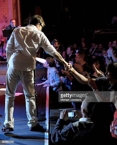 Vocalist Rivers Cuomo of Weezer shakes a fan's hand following Weezer's performance on SIRIUS XM's Artist Confidential series at the SIRIUS XM Studio...