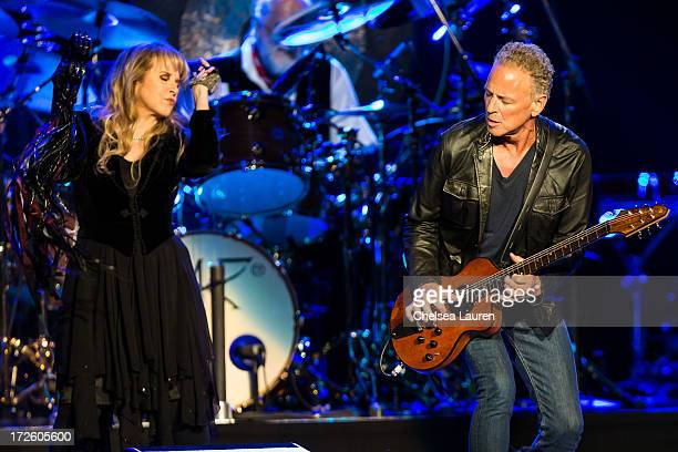 Vocalist Stevie Nicks and vocalist/guitarist Lindsey Buckingham of Fleetwood Mac perform at Staples Center on July 3 2013 in Los Angeles California