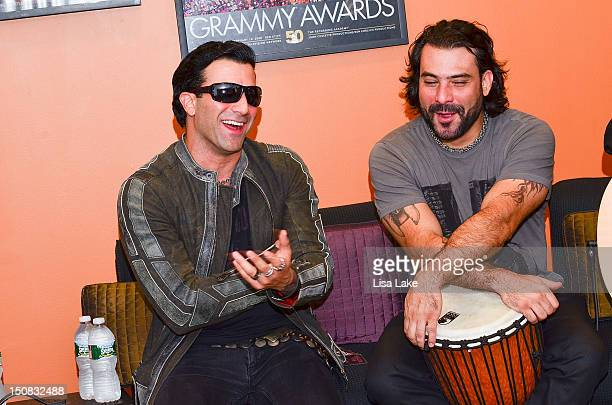 Vocalist Taki Sassaris and drummer Alex Sassaris of the band Eve to Adam perform acoustic while visiting at The Recording Academy Philadelphia...