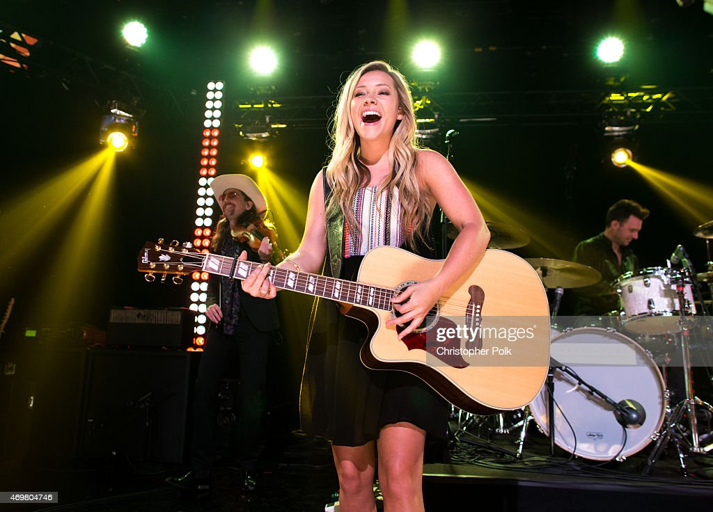 Vocalist Taylor Dye of the musical duo Maddie and Tae performs at the 'Reba and Friends Outnumber Hunger' concert event on Tuesday, March 31, 2015 in Burbank, California. Tune in starting April 17, 2015 to the 'Reba and Friends Outnumber Hunger' concert event, which officially launches the fourth annual Outnumber Hunger campaign. This collaboration between General Mills, Big Machine Label Group and Feeding America highlights the issue of hunger in America and helps provide meals to people and families in need. Reba headlines along with performances by Tim McGraw, Rascal Flatts, Florida Georgia Line, Eli Young Band and Maddie & Tae. Visit OutnumberHunger.com for local listings.