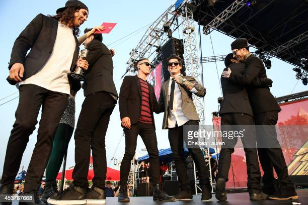 Vocalist Telle Smith of The Word Alive and vocalist Vic Fuentes drummer Mike Fuentes bassist Jaime Preciado and guiratist Tony Perry of Pierce the...