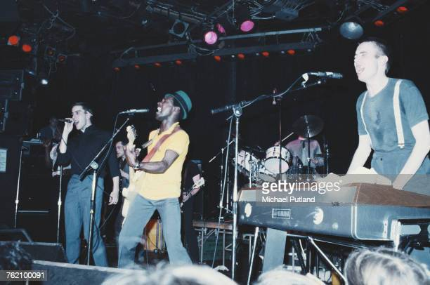 Vocalist Terry Hall guitarist Lynval Golding and keyboard player Jerry Dammers of English ska group The Specials perform live on stage in Los Angeles...