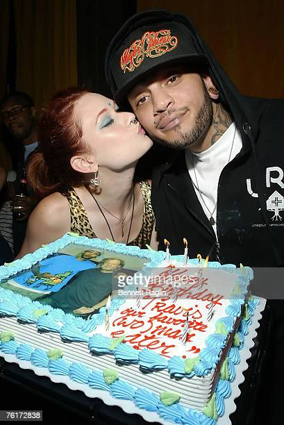 Vocalist Travis McCoy of Gym Class Heroes gets a birthday kiss from Penthouse Pet Justine Joli during his birthday party at Angels Kings August 18...