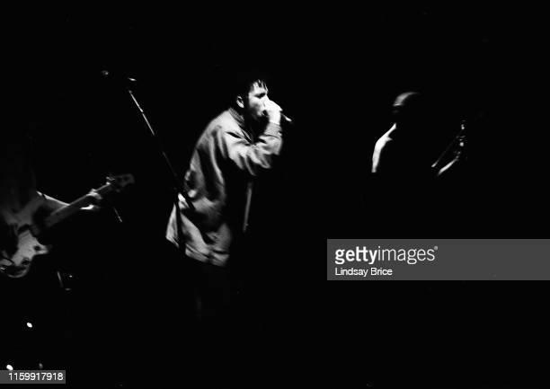 Vocalist Zack de la Rocha with bassist Tim Commerford drummer Brad Wilk and guitarist Tom Morello perform in Rage Against the Machine at Club...