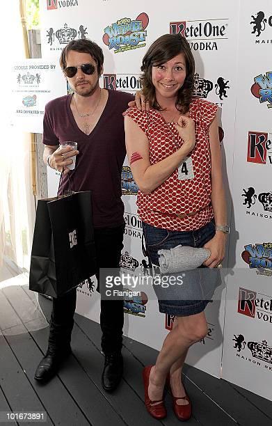 Vocalist/Guitarist Brian Aubert and Bassist Nikki Monninger of Silversun Pickups attend the 2010 KROQ Weenie Roast at Verizon Wireless Amphitheatre...