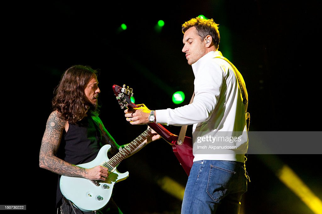 Vocalist/guitarist Nick Hexum (R) and lead guitarist Tim Mahoney of 311 perform onstage at Verizon Wireless Amphitheatre on August 24, 2012 in Laguna Hills, California.