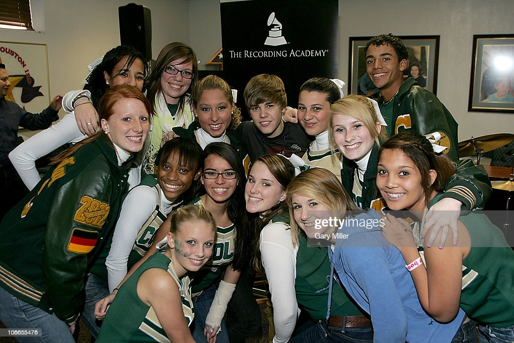 Grammy meet and greet with justin bieber photos and images getty vocalistmusician justin bieber poses with members of the cole high bandcheerleaders m4hsunfo