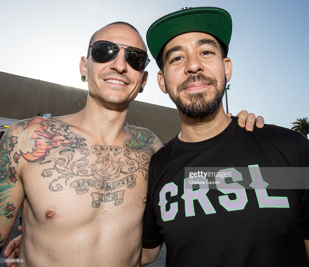 Vocalists Chester Bennington (L) and Mike Shinoda of Linkin Park pose backstage during the Vans Warped Tour on June 22, 2014 in Ventura, California.