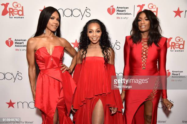 Vocalists Cindy HerronBraggs Terry Ellis and Rhona Bennett of En Vogue attend the American Heart Association's Go Red For Women Red Dress Collection...