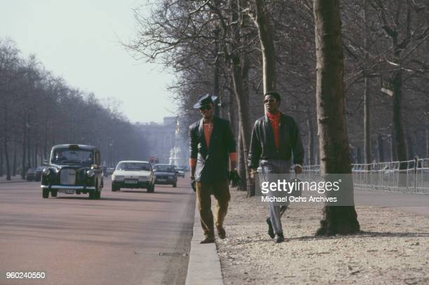 Vocalists John 'Ecstasy' Fletcher and Jalil Hutchins of American hip hop group Whodini walking down The Mall London circa 1986