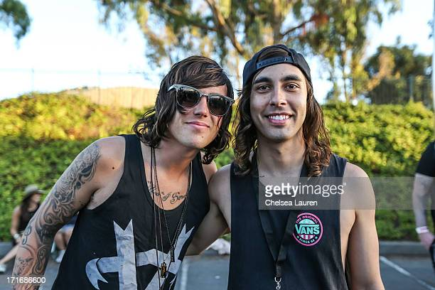 Vocalists Kellin Quinn of Sleeping With Sirens and Vic Fuentes of Pierce the Veil pose backstage at the Vans Warped Tour at the Cricket Wireless...