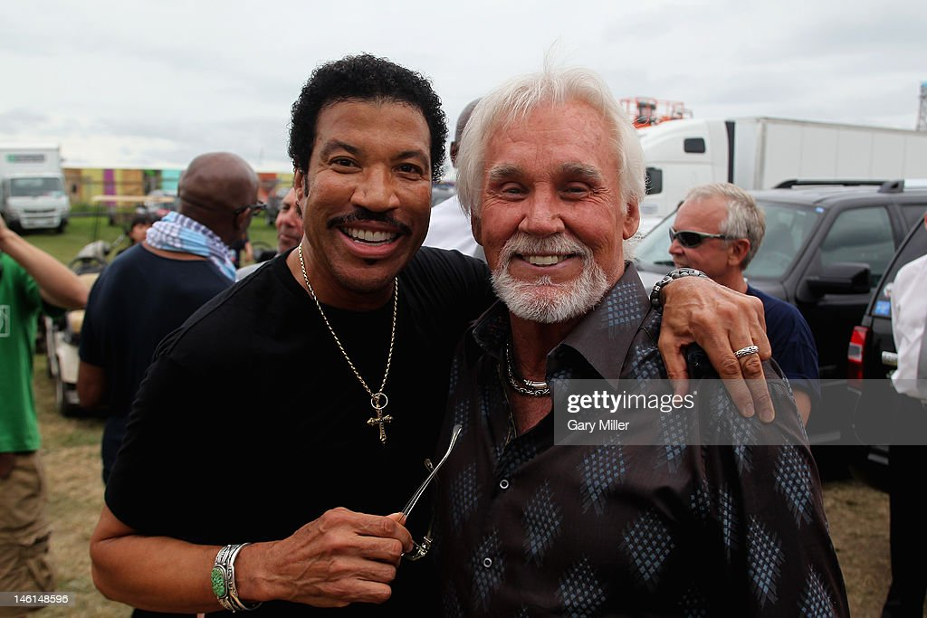 Vocalists Lionel Richie (L) and Kenny Rogers are seen here backstage during the 2012 Bonnaroo Music and Arts Festival on June 10, 2012 in Manchester, Tennessee.