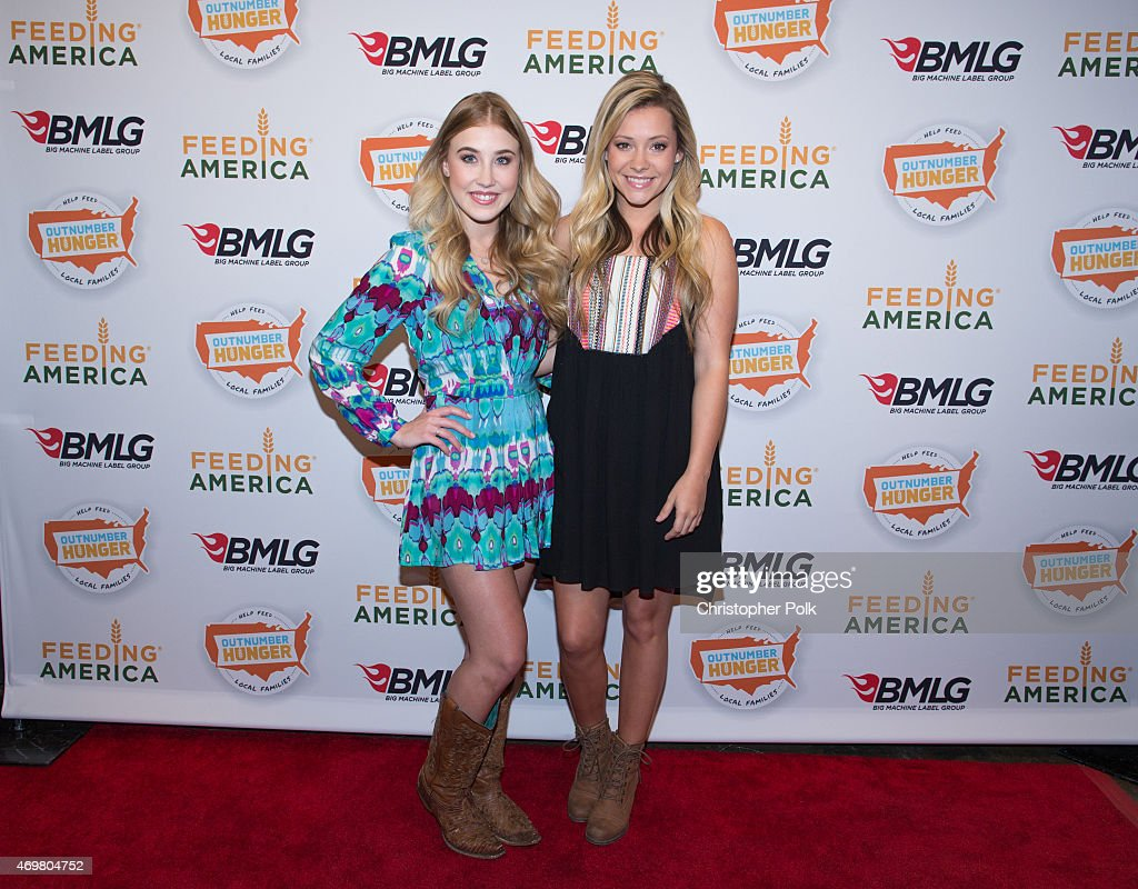 Vocalists Madison Marlow (L) and Taylor Dye of the musical duo Maddie and Tae pose at the 'Reba and Friends Outnumber Hunger' concert event on Tuesday, March 31, 2015 in Burbank, California. Tune in starting April 17, 2015 to the 'Reba and Friends Outnumber Hunger' concert event, which officially launches the fourth annual Outnumber Hunger campaign. This collaboration between General Mills, Big Machine Label Group and Feeding America highlights the issue of hunger in America and helps provide meals to people and families in need. Reba headlines along with performances by Tim McGraw, Rascal Flatts, Florida Georgia Line, Eli Young Band and Maddie & Tae. Visit OutnumberHunger.com for local listings.