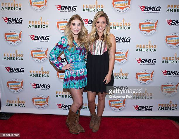 Vocalists Madison Marlow and Taylor Dye of the musical duo Maddie and Tae pose at the 'Reba and Friends Outnumber Hunger' concert event on Tuesday...