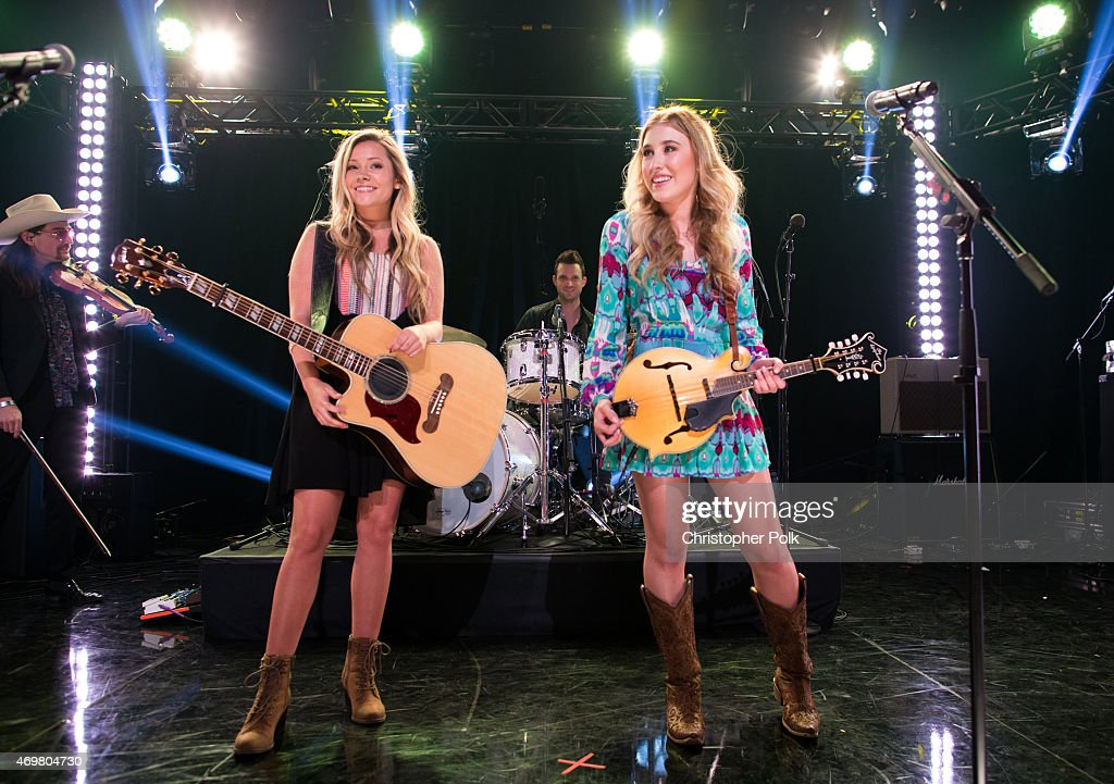 Vocalists Taylor Dye (L) and Madison Marlow of the musical duo Maddie and Tae perform at the 'Reba and Friends Outnumber Hunger' concert event on Tuesday, March 31, 2015 in Burbank, California. Tune in starting April 17, 2015 to the 'Reba and Friends Outnumber Hunger' concert event, which officially launches the fourth annual Outnumber Hunger campaign. This collaboration between General Mills, Big Machine Label Group and Feeding America highlights the issue of hunger in America and helps provide meals to people and families in need. Reba headlines along with performances by Tim McGraw, Rascal Flatts, Florida Georgia Line, Eli Young Band and Maddie & Tae. Visit OutnumberHunger.com for local listings.