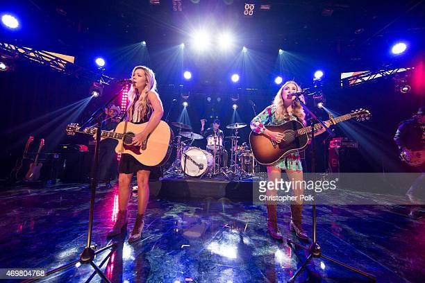 Vocalists Taylor Dye and Madison Marlow of the musical duo Maddie and Tae perform at the Reba and Friends Outnumber Hunger concert event on Tuesday...