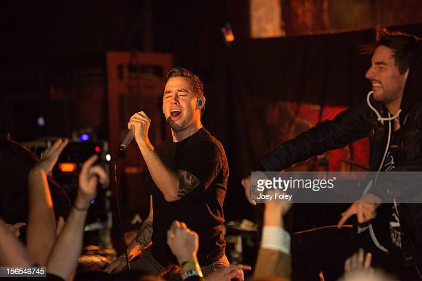 Vocalists Tyler Carter and Michael Bohn of the rock band Issues performs at The Emerson Theater on November 6 2012 in Indianapolis Indiana