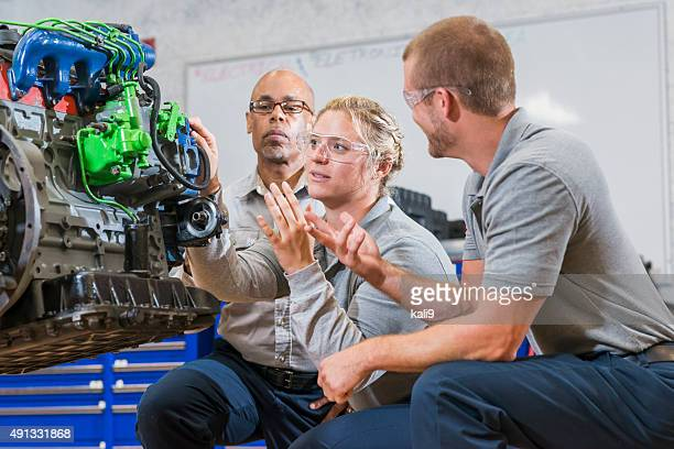 Vocational class, learning to repair diesel engine