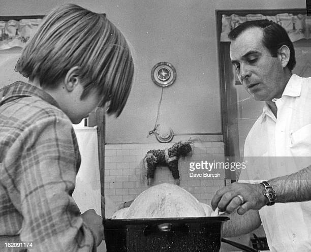 MAR 2 1968 MAR 12 1968 MAR 17 1968 Vocational counselor Jim Hicks helps a boy at Hallway House prepare turkey for evening meal The boys are...