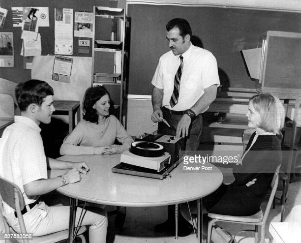 Vocational counselor shows students New Audio Visual Kits Charles Epperson standing Alameda High vocational counselor instructs students in The...