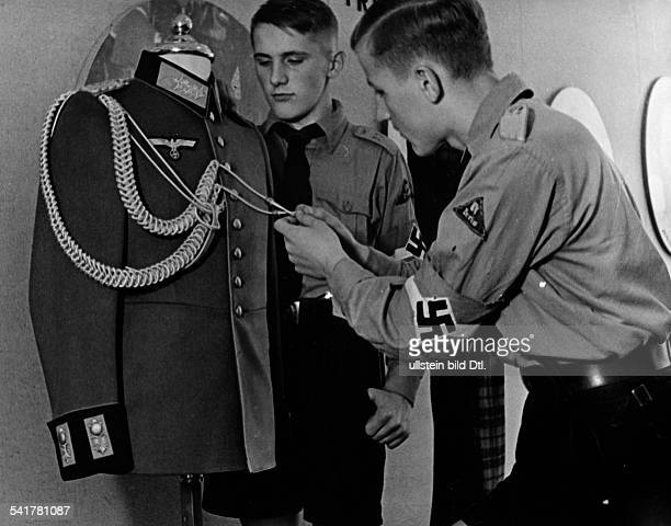 Vocational guidance for members of the Hitler Youth Hitlerjugend members inspecting uniform of the Wehrmacht the German armed forces Photographer...