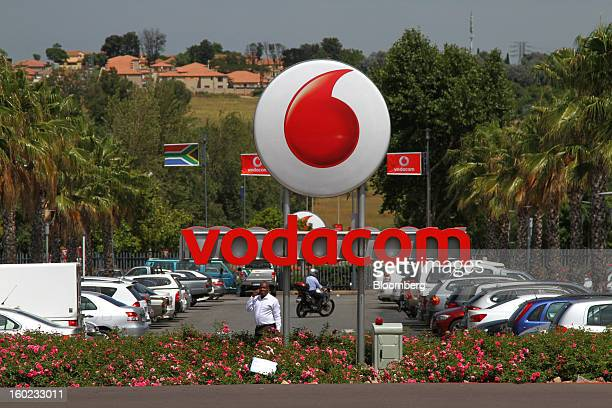 A Vodacom logo stands near a parking lot outside the headquarters of Vodacom Group Ltd Vodafone's biggest African business in Johannesburg South...