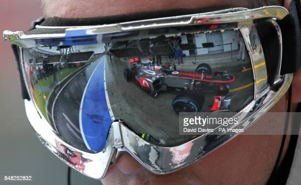 ab932cdccbc Vodafone McLaren Mercedes driver Jenson Button is seen in the reflection of his  mechanics goggles during