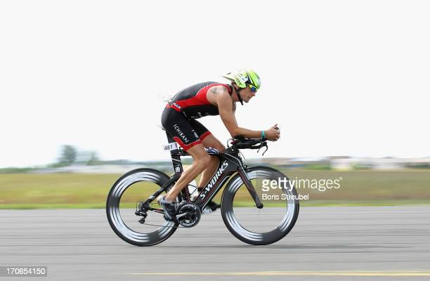 Vodafone McLaren Mercedes Formula 1 driver Jenson Button cycles during the Ironman 703 on June 16 2013 in Berlin Germany