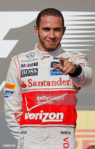 Vodafone McLaren Mercedes Lewis Hamilton of Britain points to the crowd after winning the United States Formula One Grand Prix at the Circuit of the...