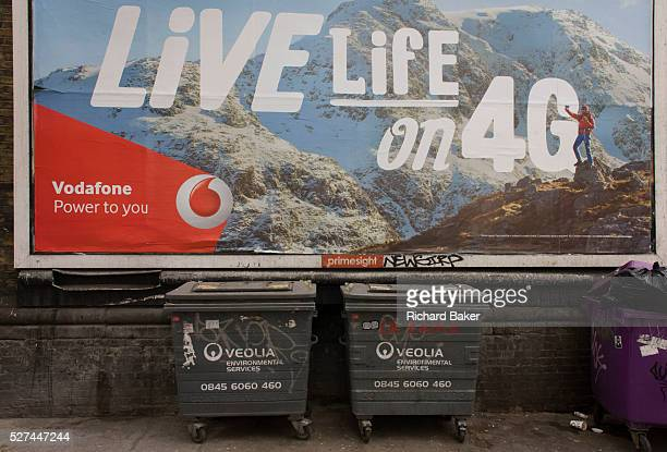 Vodafone mountains ad for 4G network services and dystopian refuse bins in south London. While a mountaineer stands on his a personal summit of...