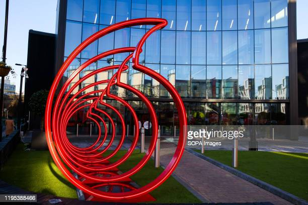 Vodafone's logo displayed at the front of its office in London, UK.