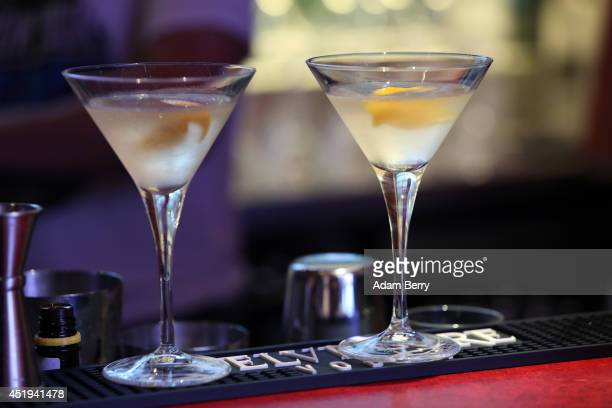 Vodka martini cocktails sit on a bar during the OpenCatwalk event at The Belvedere Hotel by Q on July 9 2014 in Berlin Germany
