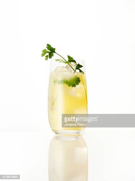 vodka, pear, ginger and coriander cocktail - vodka stock pictures, royalty-free photos & images