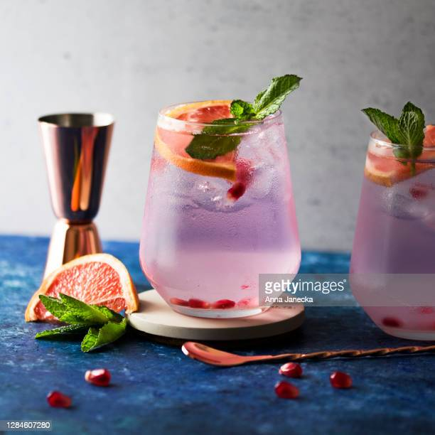 vodka with cranberry and grapefruit - pink colour stock pictures, royalty-free photos & images