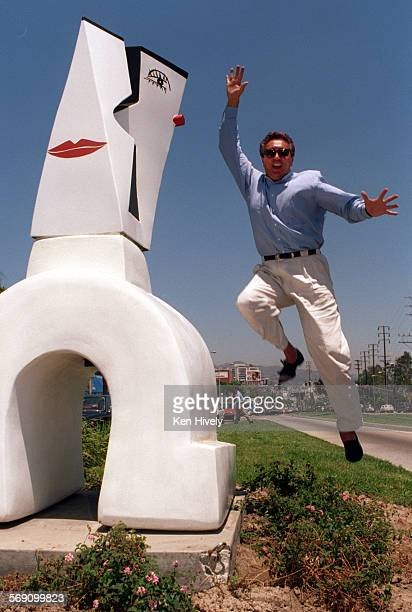 Vodka–Artist Nini Policapelli jumps for joy over the new location of his sculpture Uno or better known in the community as The Kiss at the corner of...
