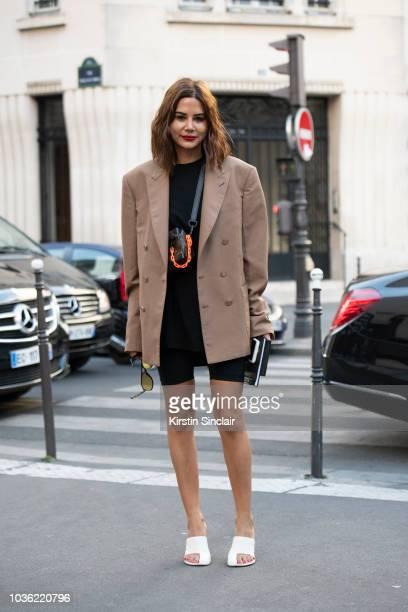 Vogue Australia senior fashion editor Christine Centenera wears a Louis Vuitton bag Celine shoes Wardobe NYC by Josh Goot shorts long sleeve T shirt...